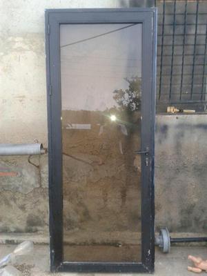 Puerta de aluminio con marco posot class for Puertas de aluminio con cristal