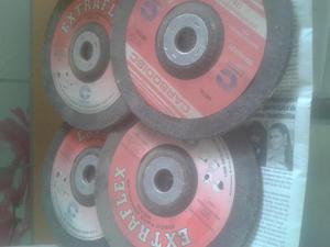disco para esmerilar y un disco de corte nuevos