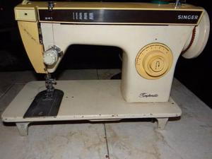 Maquina de coser singer usada.