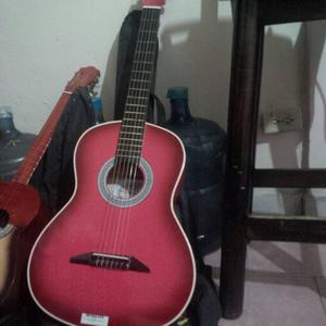 guitarra y cuatro